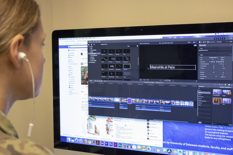 Student using video editing software in the SMDC.