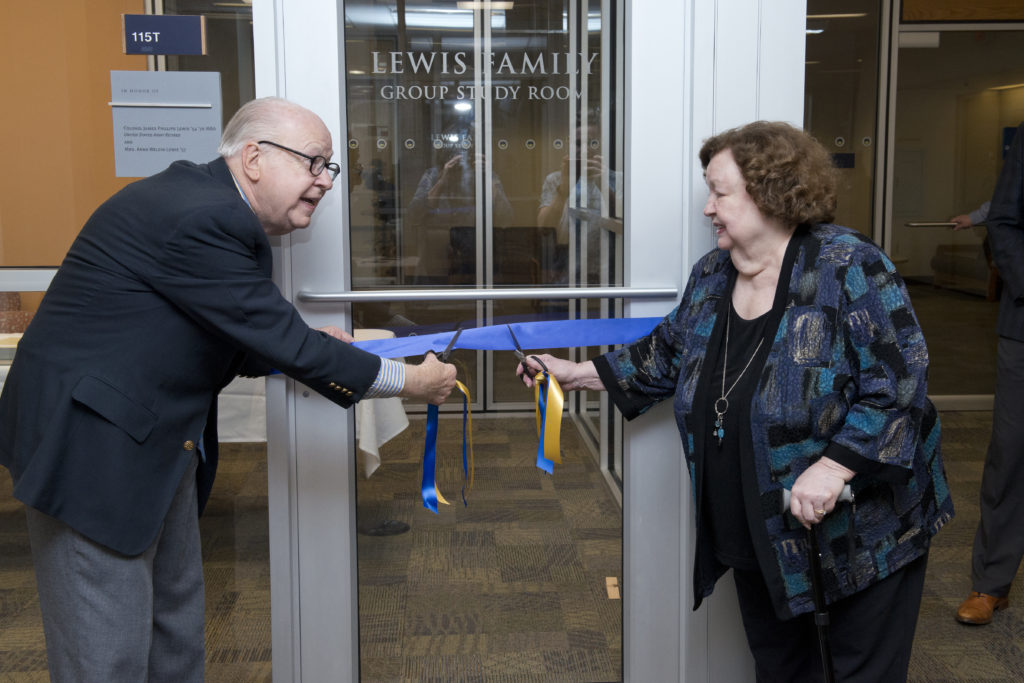 James and Ann Weldin Lewis cutting the ribbon at the ceremony for the Lewis Group Study Room.