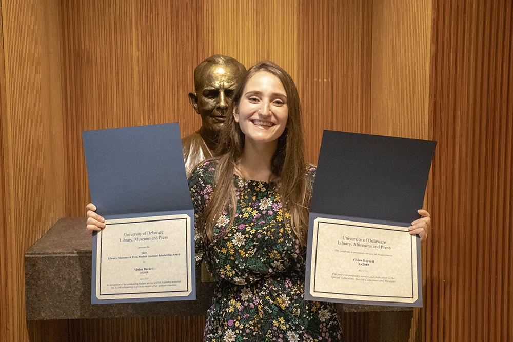 Vivien Barnett poses with her award certificate.