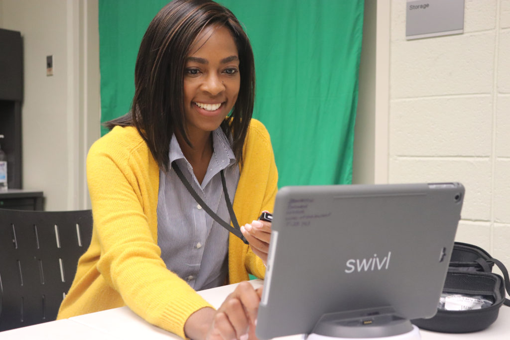 Ameerah Stafford, associate director of the Education Resource Center demonstrates the use of a Swivl and iPad.