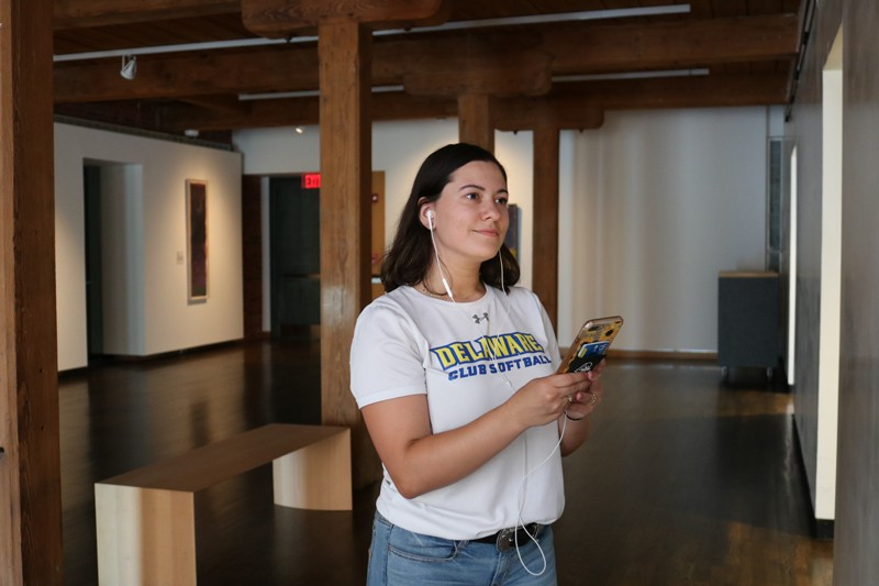 A first-year student listens to a podcast about artwork on view in Mechanical Hall Gallery