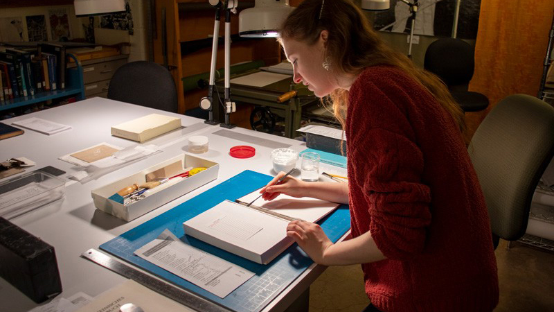 Collecting and preserving books are two ways to create resources for future generations to look back on. In addition to her collecting efforts, Miriam-Helene Rudd helps preserve and repair books as a student assistant in Morris Library.