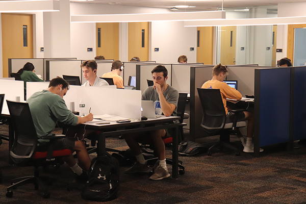 Students working at tables and carrels in the new Graduate Student Study Area.