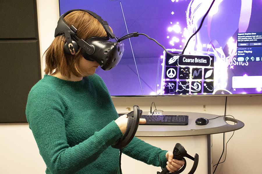 Librarian Amanda McCollom demonstrates the use of the Tilt Brush application in the VR Studio.
