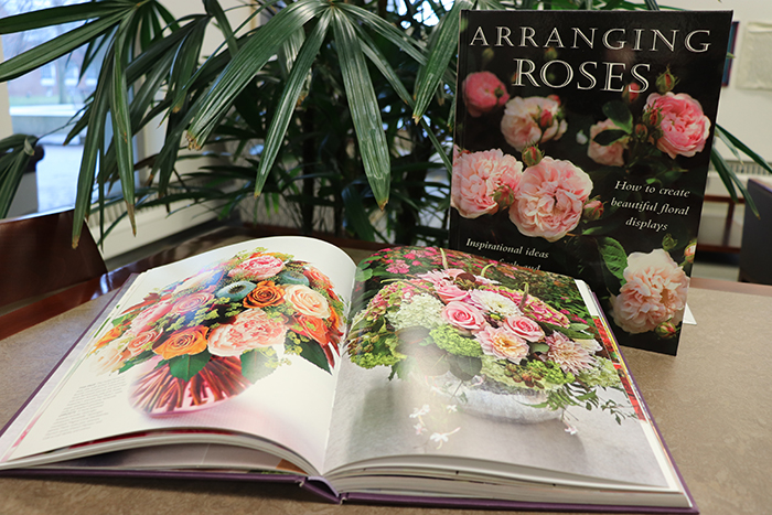 Books on flower arranging displayed on a table.