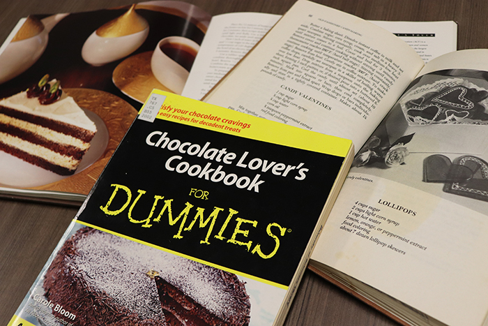 Chocolate-making books arranged on a table