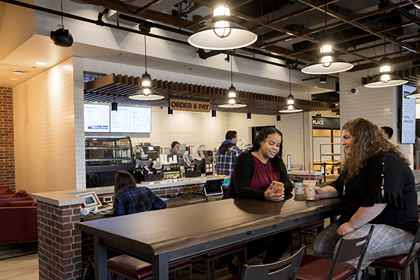 Students eat and socialize inside The Nest eatery.