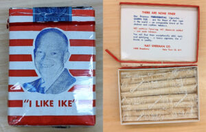 """On the left, a carton of cigarettes wrapped in red and white. On top of the stripes is a photo of Dwight Eisenhower with the phrase, """"I like Ike."""" On the left, an open box of cigars that have """"Win with Nixon"""" inscribed on the actual cigar."""