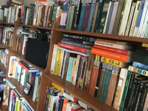 A side view of bookshelves filled with books.