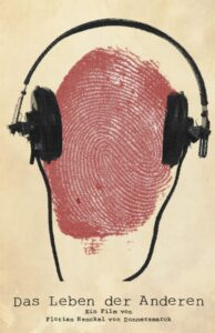 A poster with a yellowed background, a red fingerprint in the place of a head, and headphones over the fingerprint as if it were a head. The name of the film is written as though typed on a typewriter.