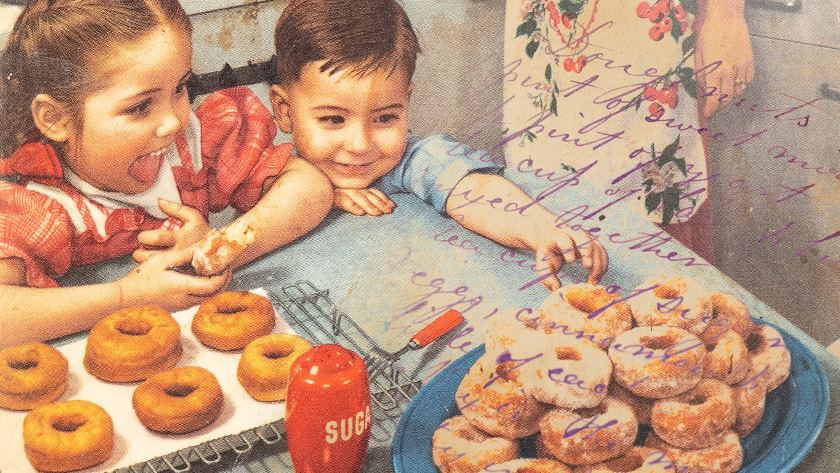 An illustration of two kids at a table excitedly reaching for freshly baked donuts.