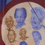 Close up of mural with Young on top right