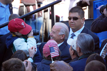 Photograph of U.S. Sen. Joseph R. Biden, Jr., greeting a young Phillies fan at presidential campaign rally on UD campus, October 31, 2008. Image L. Rebecca Johnson Melvin.